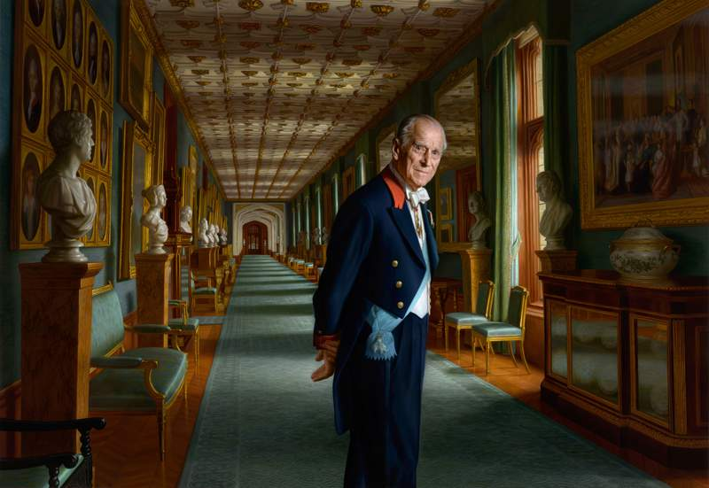 In this undated handout issued by Buckingham Palace of a painting by Australian-born artist Ralph Heimans, Prince Philip, Duke of Edinburgh, is photographed in the year of his retirement from public engagements set in The Grand Corridor at Windsor Castle. He's shown wearing the sash of the Order of the Elephant, Denmark's highest-ranking honor in 2017 in England.