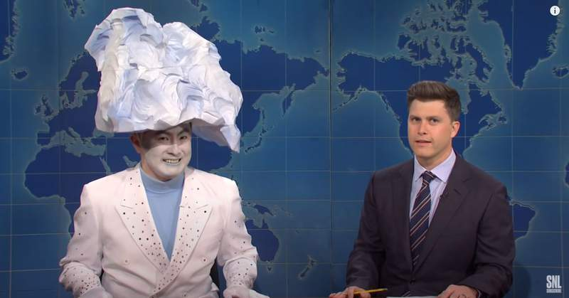 """Bowen Yang (left) who played the """"Iceberg that sunk the Titanic"""" with Colin Jost during SNL's Weekend Update."""