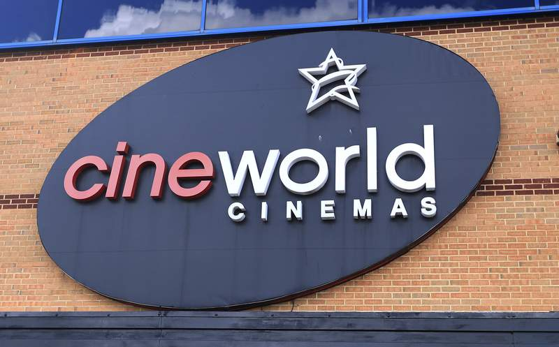 FILE - This June 18, 2020 file photo shows the logo of a Cineworld cinema in Northampton, England. U.K. media say cinema chain Cineworld will close all its U.K. venues after the postponement of the new James Bond film left a big hole in theaters schedules. The Sunday Times reported on Sunday, Oct, 4 that Cineworlds 128 theaters in the U.K. and Ireland will shut in the coming weeks, putting up to 5,500 people out of work. (Mike Egerton/PA via AP, file)