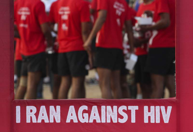 FILE - In this Dec. 1, 2018, file photo, Indians participate in a health awareness run to mark World AIDS Day in Hyderabad, India. New numbers on the global AIDS epidemic show some big successes such as fewer deaths and new infections. But there are also some tragic failures: Only half of children with HIV, the virus that causes the disease, are getting treatment. UNAIDS, a United Nations agency, reported last year's numbers Monday, July 6, 2020, at the start of an international AIDS conference. (AP Photo/Mahesh Kumar A., File)
