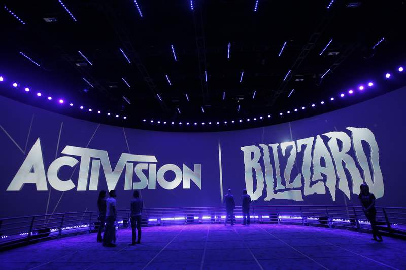 FILE - This June 13, 2013 file photo shows the Activision Blizzard Booth during the Electronic Entertainment Expo in Los Angeles. Activision Blizzard, one of the worlds most high-profile video game companies, confirmed an SEC probe and said it is working to address complaints of workplace discrimination. The Santa Monica, California, company said Tuesday, Sept. 21, 2021,  that it is complying with a recent Securities and Exchange Commission subpoena sent to current and former employees and executives and the company itself on employment matters and related issues.  (AP Photo/Jae C. Hong, File)