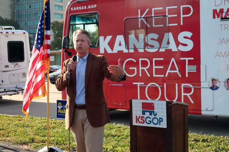"""U.S. Rep. Roger Marshall, R-Kan., the Republican nominee for an open U.S. Senate seat in Kansas, speaks during a stop in a GOP bus tour of the state, Tuesday, Oct. 6, 2020, in Topeka, Kan. Asked about President Donald Trump's tweet after being treated for coronavirus that people should not fear COVID-19, Marshall told reporters, """"Of course, I think everyone should respect the virus."""" (AP Photo/John Hanna)"""