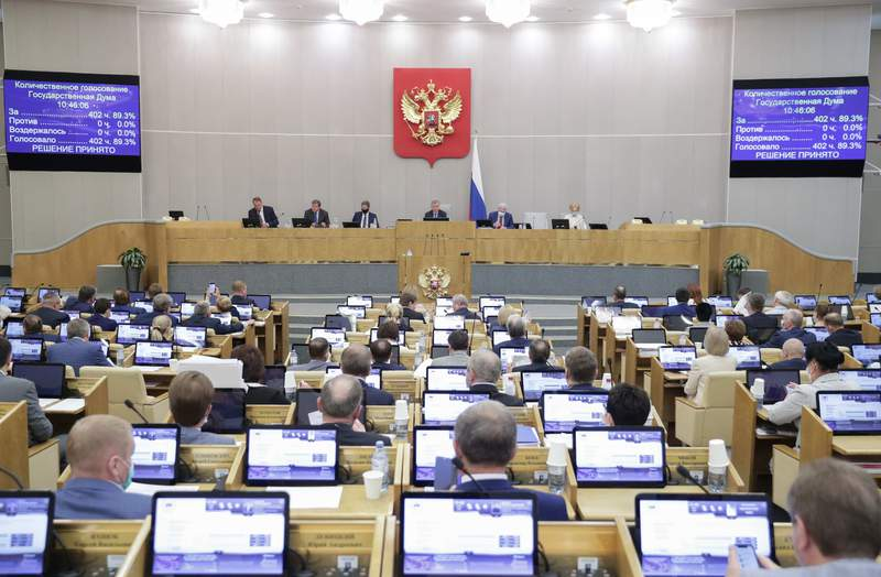 In this photo provided by the State Duma, deputies attend a session at the State Duma, the Lower House of the Russian Parliament in Moscow, Russia, Wednesday, May 19, 2021. The Russian parliament's lower house has voted to withdraw from an international treaty allowing surveillance flights over military facilities following the U.S. departure from the pact. The Russian exit from the Open Skies Treaty is yet to be endorsed by the upper house of parliament and needs to be signed by President Vladimir Putin to take effect. (The State Duma, The Federal Assembly of The Russian Federation via AP)