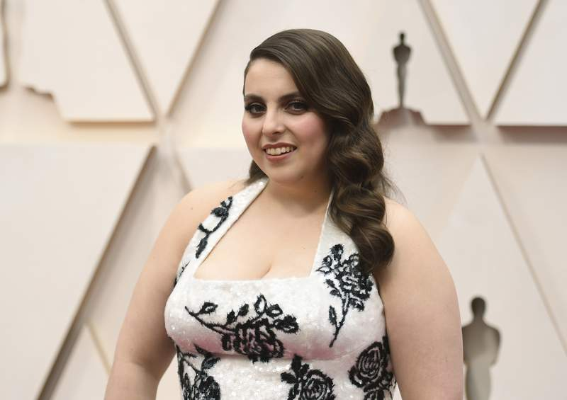 """FILE - Beanie Feldstein arrives at the Oscars on Feb. 9, 2020, in Los Angeles. A Broadway revival of """"Funny Girl"""" is aiming to open next year with Feldstein in the starring role originated by Barbra Streisand. Producers announced Wednesday, Aug. 11, 2021, that the """"Booksmart"""" and """"Lady Bird"""" actor will star as Ziegfeld Follies comedian Fanny Brice in spring 2022 at a Broadway theater to be announced. (Photo by Richard Shotwell/Invision/AP, File)"""