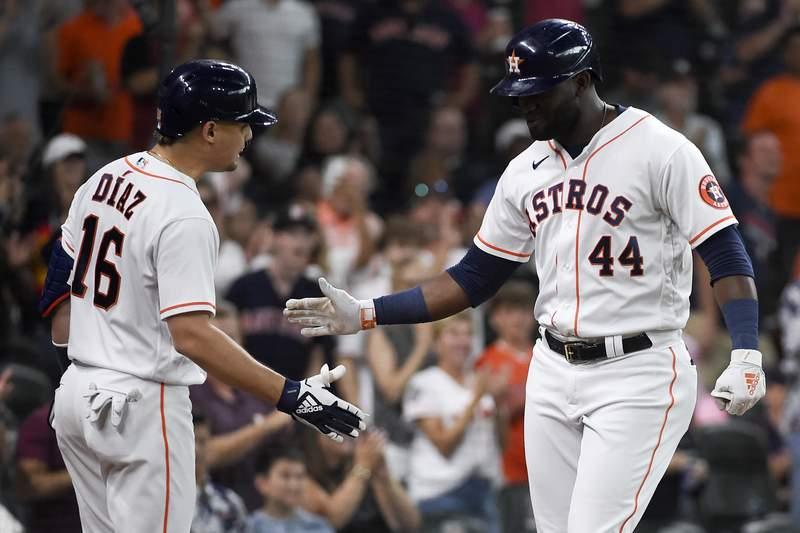 Houston Astros' Yordan Alvarez (44) celebrates his solo home run with Aledmys Diaz during the fourth inning of a baseball game against the Minnesota Twins, Saturday, Aug. 7, 2021, in Houston. (AP Photo/Eric Christian Smith)