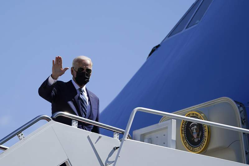 President Joe Biden waves as he boards Air Force One upon departure, Thursday, May 6, 2021, at Andrews Air Force Base, Md. Biden is en route to Louisiana. (AP Photo/Alex Brandon)
