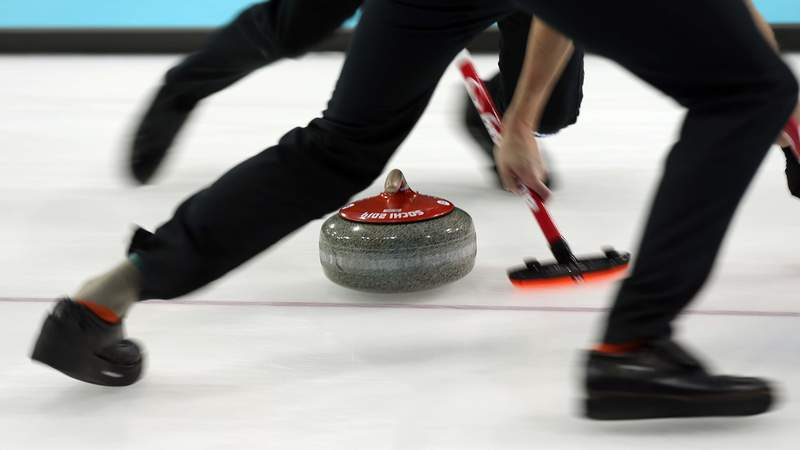 Feb 11, 2014; Sochi, RUSSIA; A general view as competitors sweep ahead of a stone in the men's round robin session during the Sochi 2014 Olympic Winter Games at Ice Cube Curling Center.