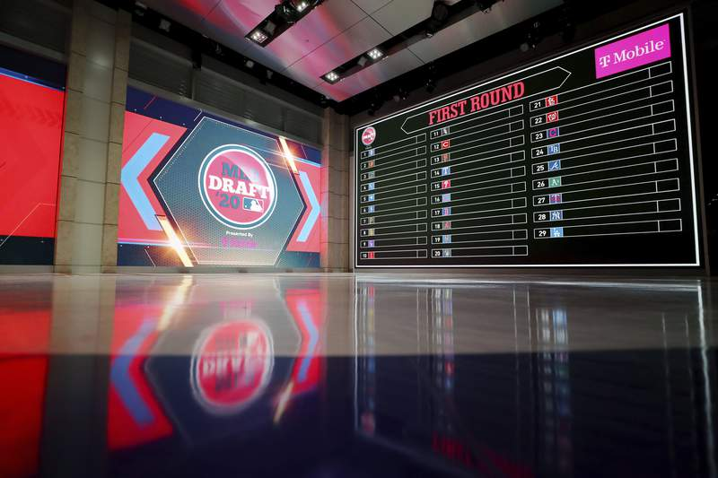 In a photo provided by MLB Photos, the baseball draft board is seen Monday, June 8, 2020 in Secaucus, N.J., for Wednesday's draft. (Alex Trautwig/MLB Photos via AP)