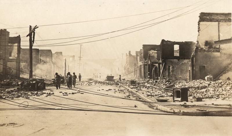 """The city's """"Black Wall Street"""" was among the most prosperous neighborhoods in America, and a Black utopia — and then it was burned to the ground."""