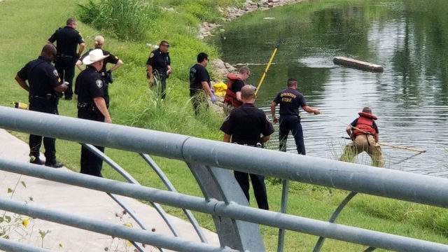 Investigators search for clues in Brays Bayou in east Houston after a body was found in the water July 30, 2018.