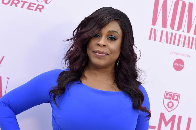 Niecy Nash arrives at The Hollywood Reporter's Women in Entertainment Breakfast Gala on Dec. 11, 2019, in Los Angeles. The actress and comedian surprised fans with a weekend wedding to singer Jessica Betts. Nash and Betts posted Instagram photos Monday, Aug. 31, 2020, of their outdoor ceremony in a lush garden setting. (Photo by Jordan Strauss/Invision/AP, File)
