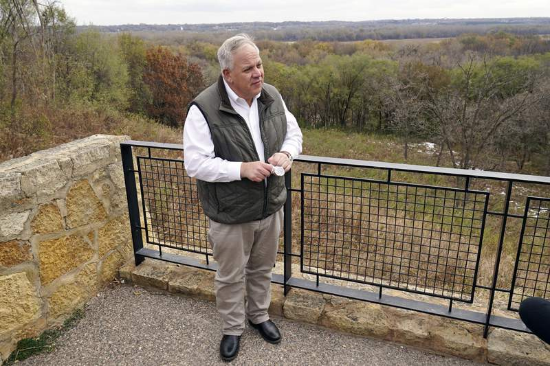 "Interior Secretary David Bernhardt takes reporters' questions overlooking the Minnesota River area after he announced the gray wolf's recovery ""a milestone of success during a stop at the Minnesota Valley National Wildlife Refuge, Thursday, Oct. 29, 2020, in Bloomington, Minn. The move stripped Endangered Species Act protections for gray wolves in most of the U.S., ending longstanding federal safeguards and putting states and tribes in charge of overseeing the predators. (AP Photo/Jim Mone)"