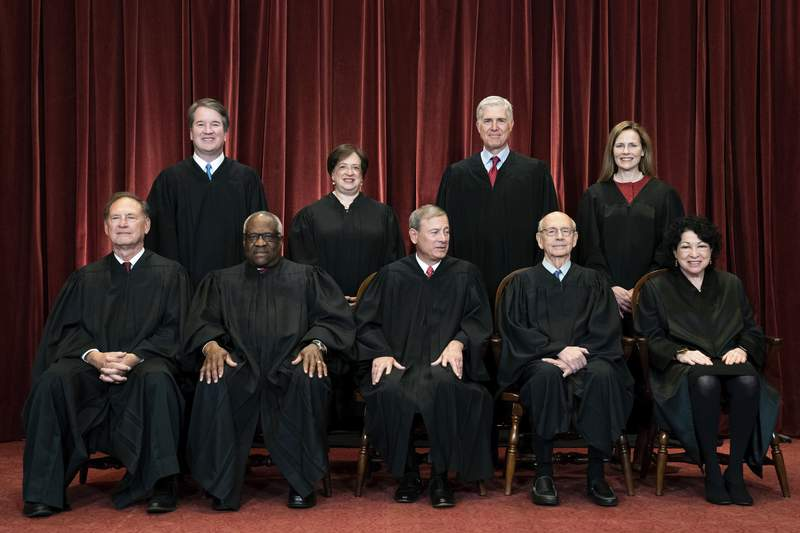 """In this April 23, 2021, file photo, members of the Supreme Court pose for a group photo at the Supreme Court in Washington. Seated from left are Associate Justice Samuel Alito, Associate Justice Clarence Thomas, Chief Justice John Roberts, Associate Justice Stephen Breyer and Associate Justice Sonia Sotomayor, Standing from left are Associate Justice Brett Kavanaugh, Associate Justice Elena Kagan, Associate Justice Neil Gorsuch and Associate Justice Amy Coney Barrett. The Supreme Court on June 28 revived claims of excessive force against St. Louis police officers in a case in which a homeless man died after being restrained in handcuffs and leg shackles. In an unsigned opinion, a majority of the court agreed to send the case back to a lower court for further review. Amid an ongoing national conversation on police practices, however, three justices said their colleagues were taking the """"easy out"""" by not hearing arguments in the case. (Erin Schaff/The New York Times via AP, Pool)"""