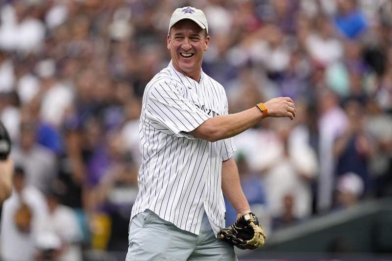 Former NFL quarterback Peyton Manning throws the ceremonial first pitch prior to the MLB All-Star baseball game, Tuesday, July 13, 2021, in Denver. (AP Photo/Jack Dempsey)