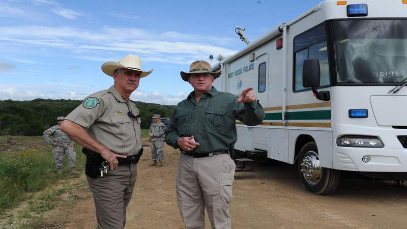 Texas Game Warden Jeff Gillenwaters and Chris Zimmer, deputy director for Fort Hood's Directorate of Emergency Services.