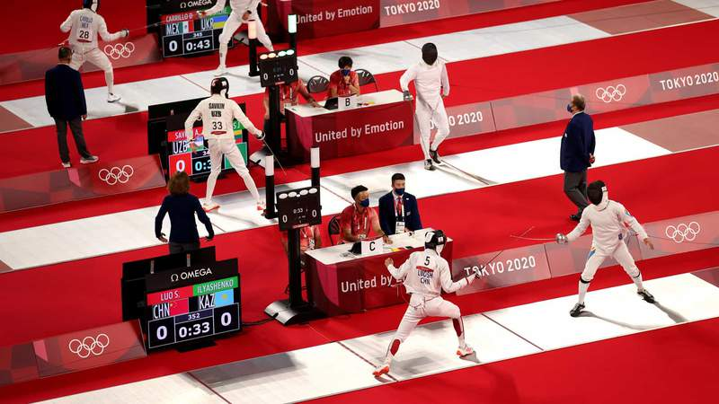 An overhead view of the fencing piste on the first day of modern pentathlon competition at the Tokyo Olympics