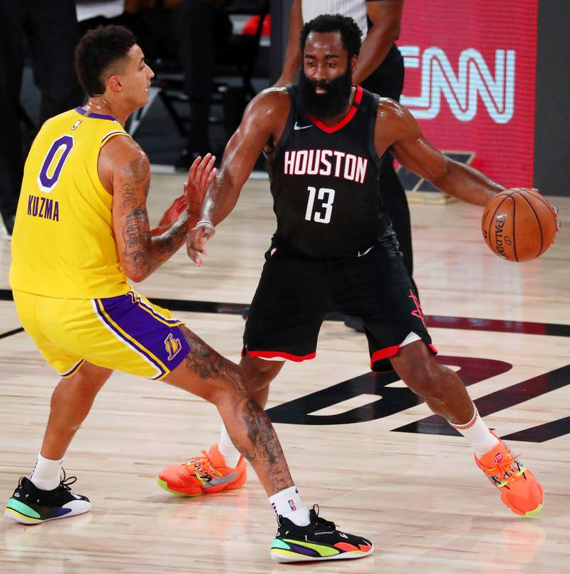 LAKE BUENA VISTA, FLORIDA - AUGUST 06:  James Harden #13 of the Houston Rockets controls the ball against Kyle Kuzma #0 of the Los Angeles Lakers in the first half at The Arena at ESPN Wide World Of Sports Complex on August 6, 2020 in Lake Buena Vista, Florida. NOTE TO USER: User expressly acknowledges and agrees that, by downloading and or using this photograph, User is consenting to the terms and conditions of the Getty Images License Agreement. (Photo by Kim Klement-Pool/Getty Images)