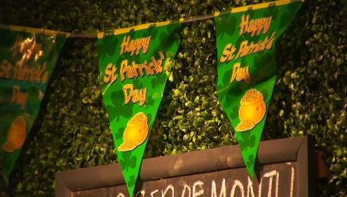St. Patrick's Day decorations hang inside Martin's Downtown.