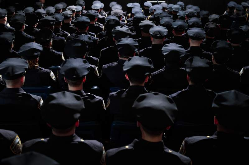 The newest members  of the New York City Police Department attend their police academy graduation ceremony.