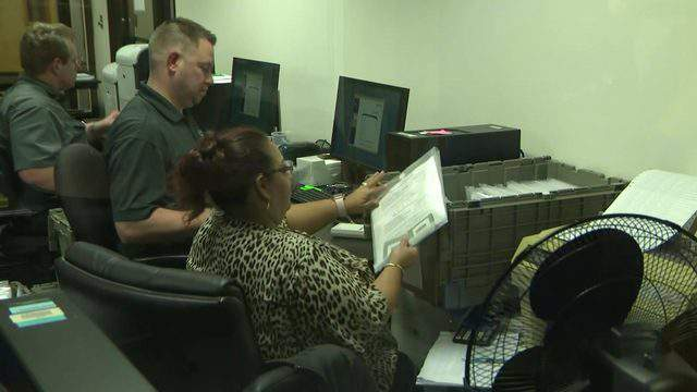Officials with the Harris County Clerk's Office count ballots on Nov. 5, 2019 after polls closed on election day.