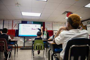 Jessica Lemmer went over a fraction problem with her third grade math class in 2018 at Edward Titche Elementary School in Dallas' Pleasant Grove area. Dallas County officials have prohibited schools this year from having in-person classes until Sept. 8.      Leslie Boorhem-Stephenson for The Texas Tribune