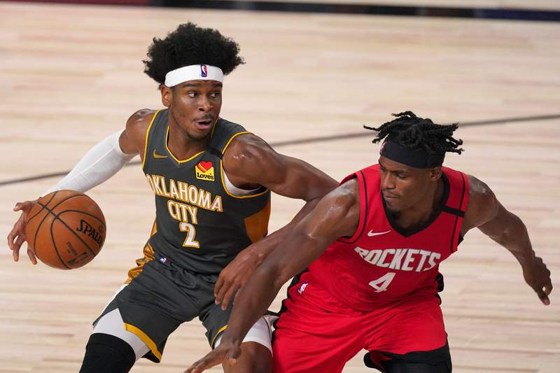 Oklahoma City Thunder's Shai Gilgeous-Alexander (2) handles the ball as Houston Rockets' Danuel House Jr. (4) defends during the second half of an NBA first-round playoff basketball game, Monday, Aug. 31, 2020, in Lake Buena Vista, Fla. (AP Photo/Mark J. Terrill)