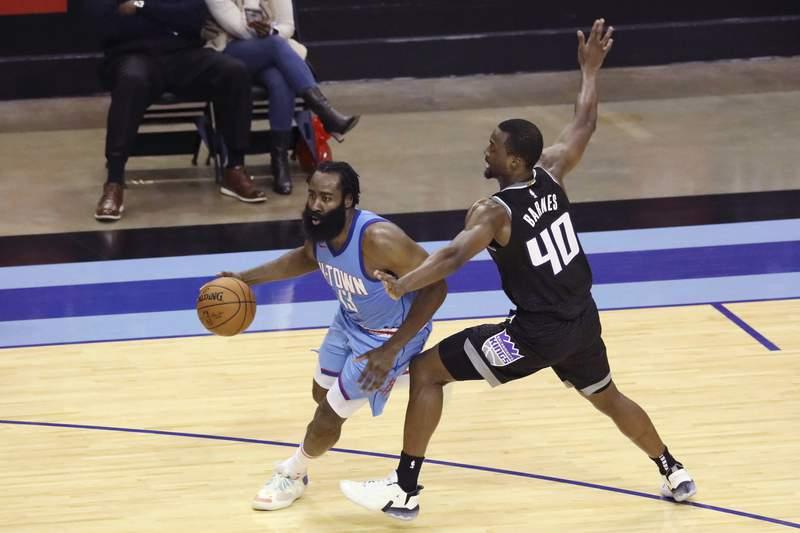 Sacramento Kings Harrison Barnes gets a hand on Houston Rockets guard James Harden during the second half of an NBA basketball game Thursday Dec. 31, 2020, in Houston. (AP Photo/Richard Carson)