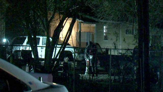 Investigators look over the scene of a homicide at a home in northeast Harris County, Texas, on Dec. 24, 2017.