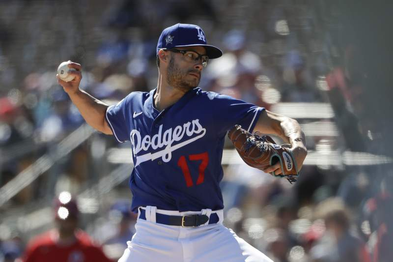 FILE PHOTO - Los Angeles Dodgers relief pitcher Joe Kelly works against a Los Angeles Angels batter during the third inning of a spring training baseball game Wednesday, Feb. 26, 2020, in Glendale, Ariz. (AP Photo/Gregory Bull)