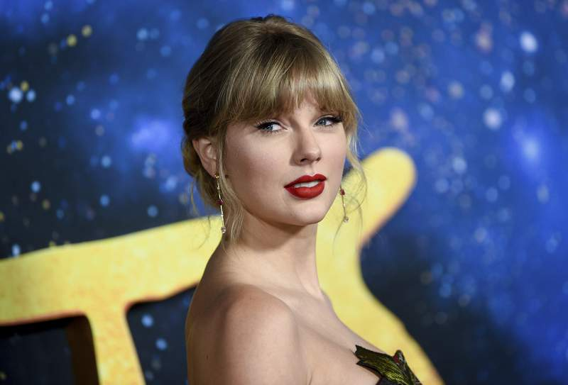 """FILE - Singer-actress Taylor Swift attends the world premiere of """"Cats"""" in New York on Dec. 16, 2019. A concert film featuring Taylor Swift performing songs from her new album is coming to Disney+. The singer announced Tuesday that folklore: the long pond studio sessions will premiere on the streaming platform on Wednesday.  (Photo by Evan Agostini/Invision/AP, File)"""