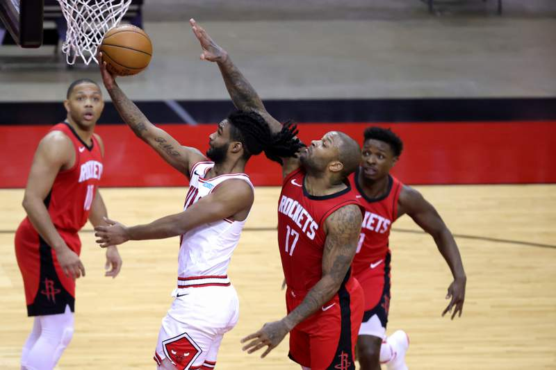 HOUSTON, TEXAS - FEBRUARY 22: Coby White #0 of the Chicago Bulls shoots a lay up ahead of P.J. Tucker #17 of the Houston Rockets during the third quarter of a game at the Toyota Center on February 22, 2021 in Houston, Texas. NOTE TO USER: User expressly acknowledges and agrees that, by downloading and or using this photograph, User is consenting to the terms and conditions of the Getty Images License Agreement. (Photo by Carmen Mandato/Getty Images)