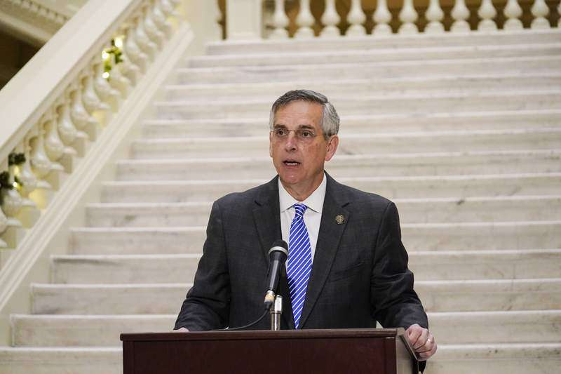 Georgia Secretary of State Brad Raffensperger speaks during a news conference on Friday, Nov. 20, 2020, in Atlanta.  Georgias top elections official said he will certify that Joe Biden won the state's presidential election after a hand tally stemming from a mandatory audit affirmed the Democrat's lead over Republican President Donald Trump.  Raffensperger said during the news conference Friday that he believes the numbers his office has presented are correct.(AP Photo/Brynn Anderson)