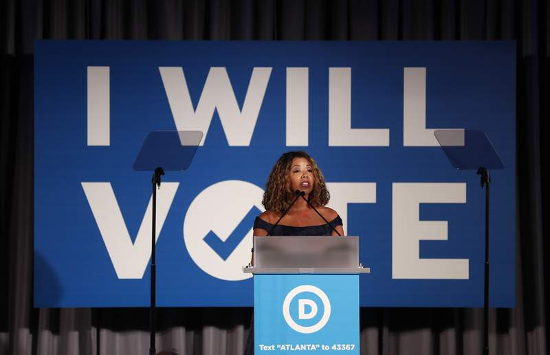 """FILE - In this Thursday, June 6, 2019 file photo, Rep. Lucy McBath, D-Ga., speaks during the """"I Will Vote"""" Fundraising Gala in Atlanta. Among voters in the 2018 midterm elections, AP VoteCast shows that Black women were more likely than women in any other racial or ethnic group to support Democratic House candidates, and their support for Democrats was also somewhat higher than among Black men. (AP Photo/John Bazemore)"""