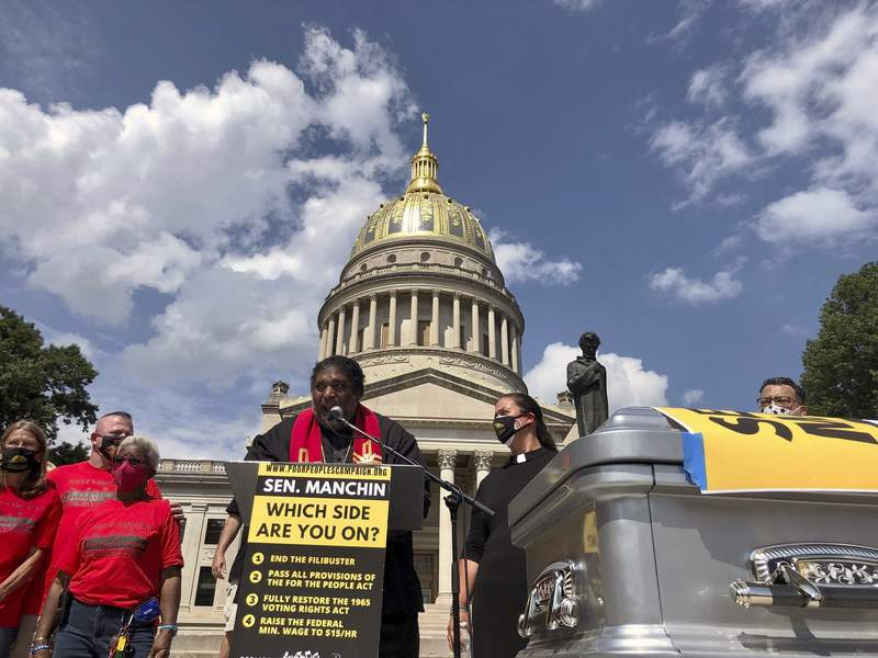 The Rev. William Barber, co-chair of the Poor People's Campaign, speaks during a rally Thursday, Aug. 26, 2021, at the state Capitol in Charleston, W.Va. The rally was aimed at applying pressure on U.S. Sen. Joe Manchin, who has opposed a sweeping overhaul of U.S. election law and a $15 federal minimum wage. (AP Photo/John Raby)