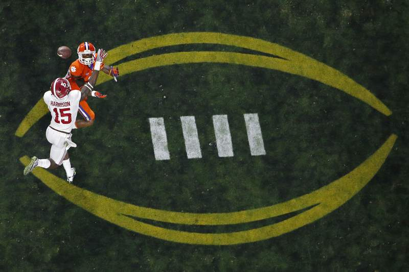 FILE - Alabama's Ronnie Harrison (15) breaks up a pass intended for Clemson's Artavis Scott during the second half of the NCAA college football playoff championship game in Glendale, Ariz., in this Monday, Jan. 11, 2016, file photo. The College Football Playoff would expand from four to 12 teams, with six spots reserved for the highest ranked conference champions, under a proposal that will be considered next week by the league commissioners who manage the postseason system, a person familiar with announcement told The Associated Press on Thursday, June 10, 2021. The person spoke on condition of anonymity because the CFP has not yet released details. (AP Photo/Ross D. Franklin, File)