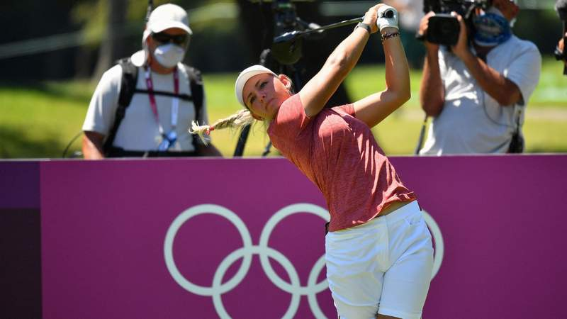 Denmark's Emily Kristine Pedersen watches her drive from the 11th tee in Round 2 of the women's golf individual stroke play during the Tokyo 2020 Olympic Games at the Kasumigaseki Country Club.