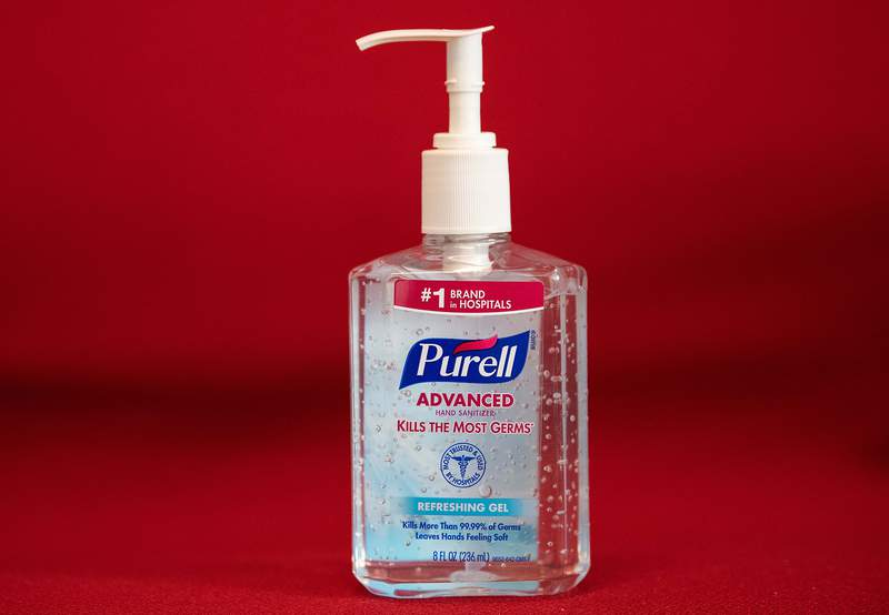 """This photo illustration shows a bottle of hand sanitizer on March 5, 2020 in Washington,DC. - Amazon pledged on March 5, 2020 to take steps to fight price gouging after a US senator complained of """"unjustifiably high prices"""" on hand sanitizers and surgical masks to protect against coronavirus infections. The US retail giant responded to a letter from Senator Ed Markey, who wrote that Amazon appeared to be profiting from panic buying related to the epidemic. (Photo by NICHOLAS KAMM / AFP) (Photo by NICHOLAS KAMM/AFP via Getty Images)"""
