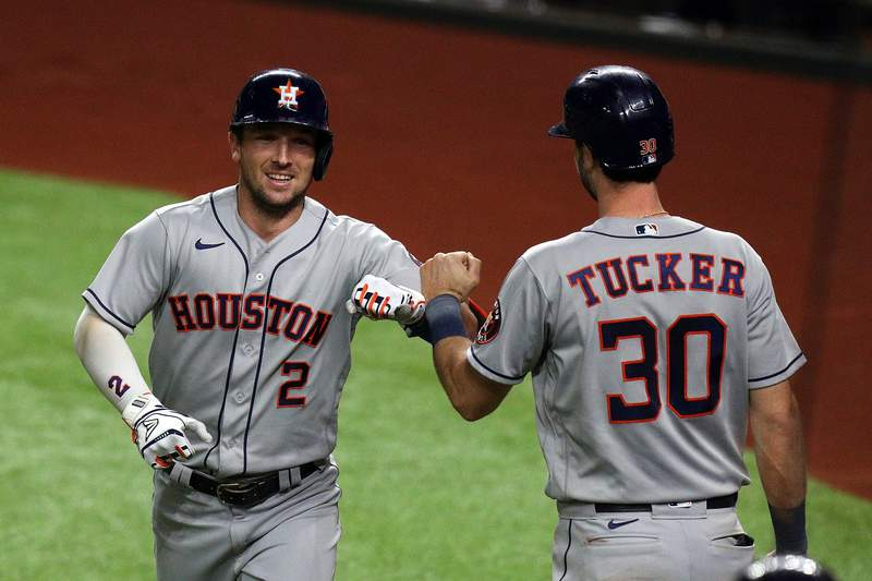 ARLINGTON, TEXAS - SEPTEMBER 24: Alex Bregman #2 of the Houston Astros fist bumps Kyle Tucker #30 after a two-run home run against the Texas Rangers in the fifth inning at Globe Life Field on September 24, 2020 in Arlington, Texas. (Photo by Richard Rodriguez/Getty Images)