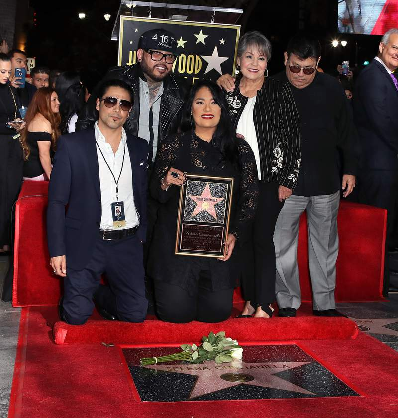 HOLLYWOOD, CA - NOVEMBER 03:  (L-R) Musician/Selena's widower Chris Perez, musician/Selena's brother A.B. Quintanilla III,, Selena's sister Suzette Quintanilla and Selena's mother and father Marcella Samora and Abraham Quintanilla Jr. attend singer Selena Quintanilla being honored posthumously with a Star on the Hollywood Walk of Fame on November 3, 2017 in Hollywood, California.  (Photo by David Livingston/Getty Images)