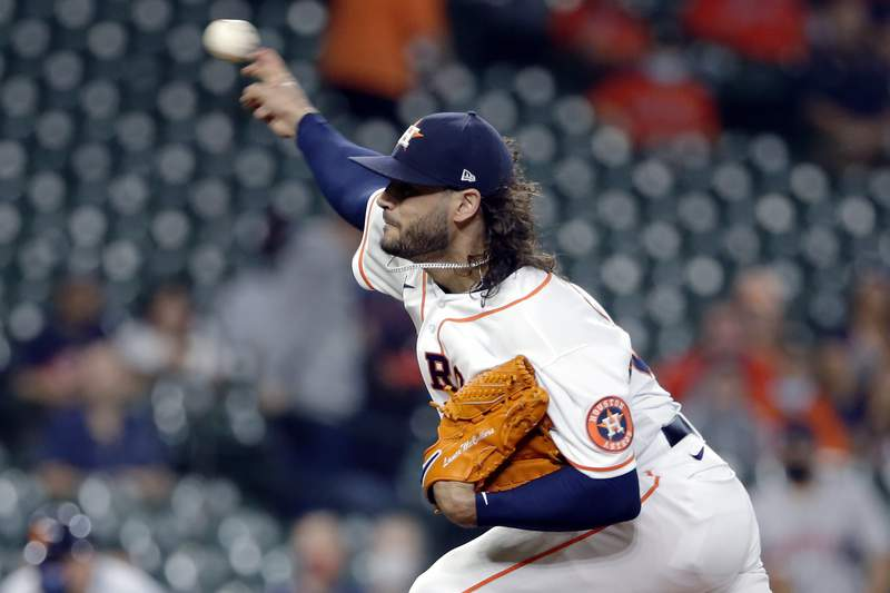 Houston Astros starting pitcher Lance McCullers Jr. throws against the Detroit Tigers during the first inning of a baseball game Wednesday, April 14, 2021, in Houston. (AP Photo/Michael Wyke)
