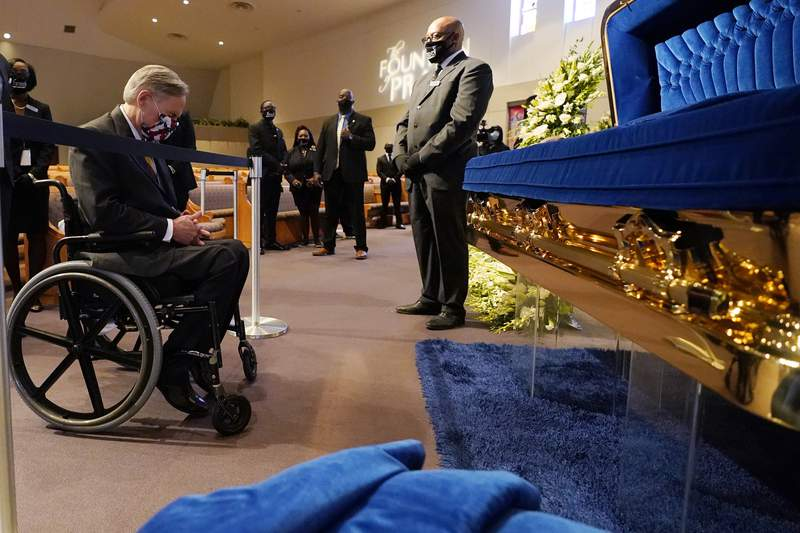 Texas Gov. Greg Abbott passes by the casket of George Floyd during a public visitation for Floyd at the Fountain of Praise church, Monday, June 8, 2020, in Houston. (AP Photo/David J. Phillip, Pool)