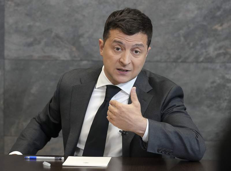 FILE - In this June 14, 2021 file photo, Ukrainian President Volodymyr Zelenskyy gestures while speaking to the media during a news conference in Kyiv, Ukraine. Zelenskyy, whose hopes for a White House meeting played a central part in former President Donald Trump's first impeachment, will finally get his chance for an Oval Office sit down with President Joe Biden on Aug. 30. (AP Photo/Efrem Lukatsky, File)
