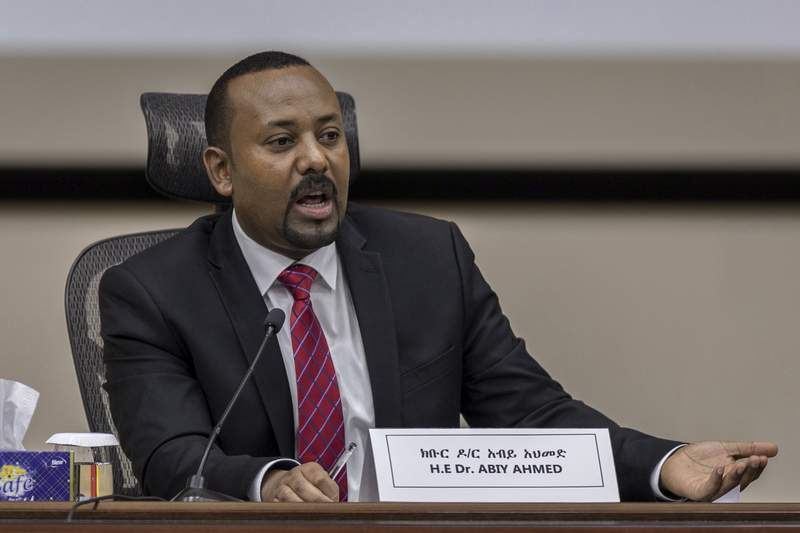 FILE - In this Monday, Nov. 30, 2020 file photo, Ethiopia's Prime Minister Abiy Ahmed responds to questions from members of parliament at the prime minister's office in the capital Addis Ababa, Ethiopia. Ethiopia's leader said in an address before lawmakers Tuesday, March 23, 2021 that atrocities have occurred in Tigray, the country's northern region where fighting persists as government troops hunt down its fugitive leaders. (AP Photo/Mulugeta Ayene, File)