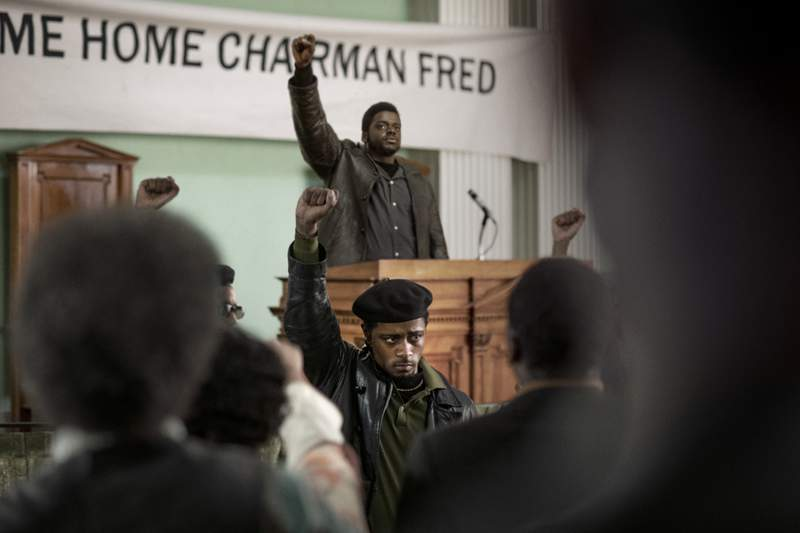 "This image released by Warner Bros. Pictures shows LaKeith Stanfield, foreground, and Daniel Kaluuya in a scene from the upcoming film ""Judas and the Black Messiah.""   The Ryan Coogler-produced Fred Hampton film will have its premiere at the Sundance Film Festival before heading to HBO Max and theaters, programmers announced Tuesday. Daniel Kaluuya plays the Black Panther Party chairman and his Get Out co-star Lakeith Stanfield plays FBI Informant William ONeill who agrees to infiltrate the group in the late 1960s. (Glen Wilson/Warner Bros. Entertainment via AP)"