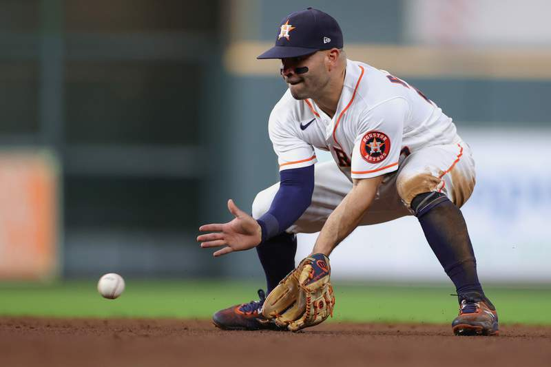 HOUSTON, TEXAS - APRIL 26: Jose Altuve #27 of the Houston Astros fields a ground ball during the ninth inning against the Seattle Mariners at Minute Maid Park on April 26, 2021 in Houston, Texas. (Photo by Carmen Mandato/Getty Images)