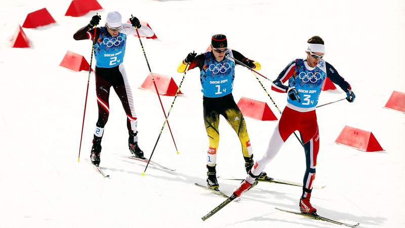 Feb 20, 2014; Krasnaya Polyana, RUSSIA; Joergen Graabak (NOR, right) Fabian Riessle (GER, center), and Mario Stecher (AUT, left) compete at the finish line in nordic combined team gundersen LH / 4x5 km during the Sochi 2014 Olympic Winter Games at RusSki Gorki Ski Jumping Center.