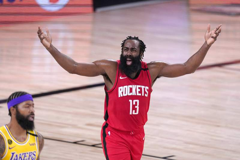 Houston Rockets' James Harden (13) reacts after being called for an offensive foul against the Los Angeles Lakers during the first half of an NBA conference semifinal playoff basketball game Thursday, Sept. 10, 2020, in Lake Buena Vista, Fla. (AP Photo/Mark J. Terrill)