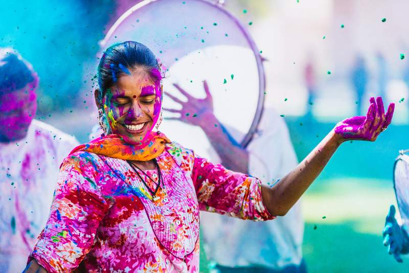 Indian people celebrating the Holi Festival of Colors.