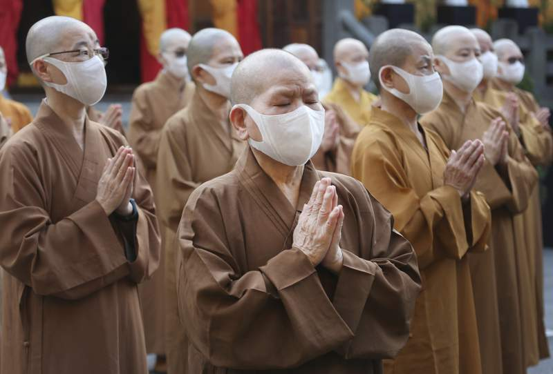 Monks and nuns pray together during Buddha's Birthday celebrations at the Lin Chi Temple in Taipei, Taiwan, Sunday, May 9, 2021. Buddha's birthday is celebrated in East Asia on the eighth day of the fourth month in the Chinese lunar calendar. (AP Photo/Chiang Ying-ying)