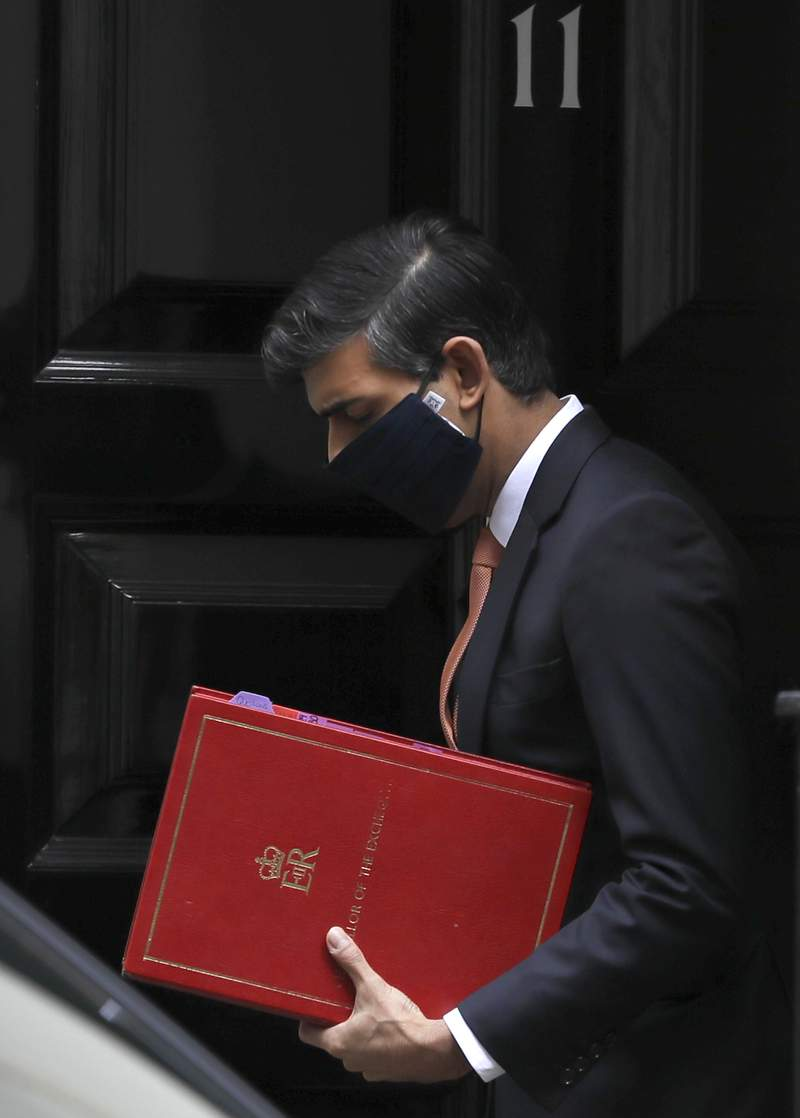 Britain's Chancellor Rishi Sunak leaves 11 Downing Street in London, Tuesday, Oct. 20, 2020. (AP Photo/Kirsty Wigglesworth)
